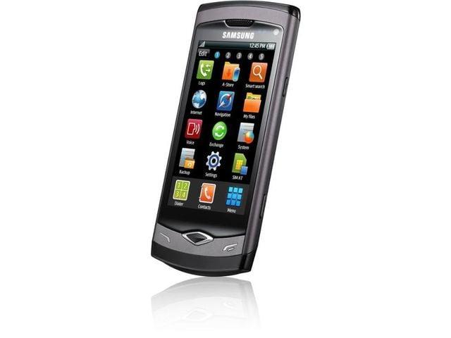obsah balení Samsung S8500 Wave + 16 GB microSD karta